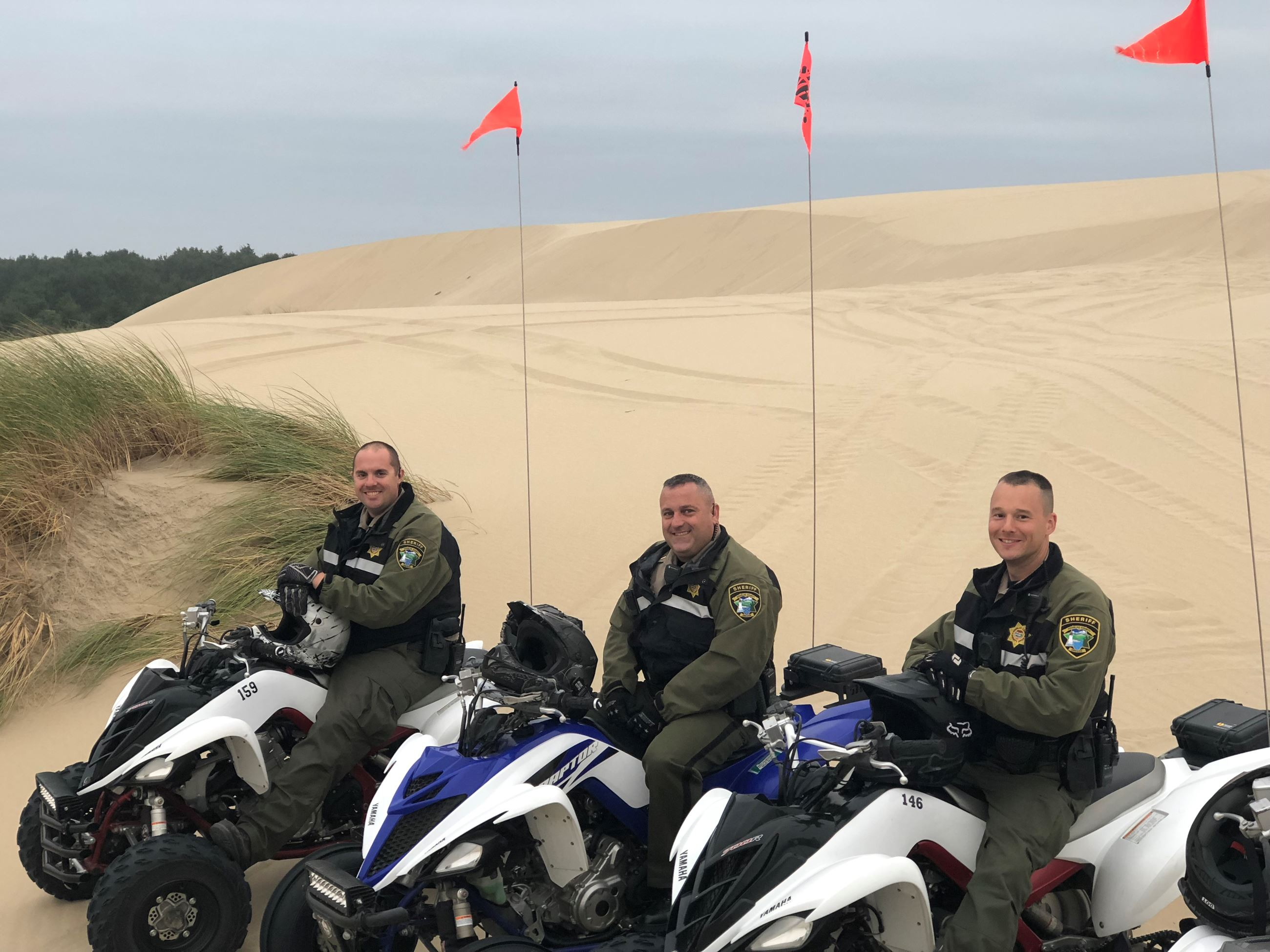 Three Police Officers on ATVs